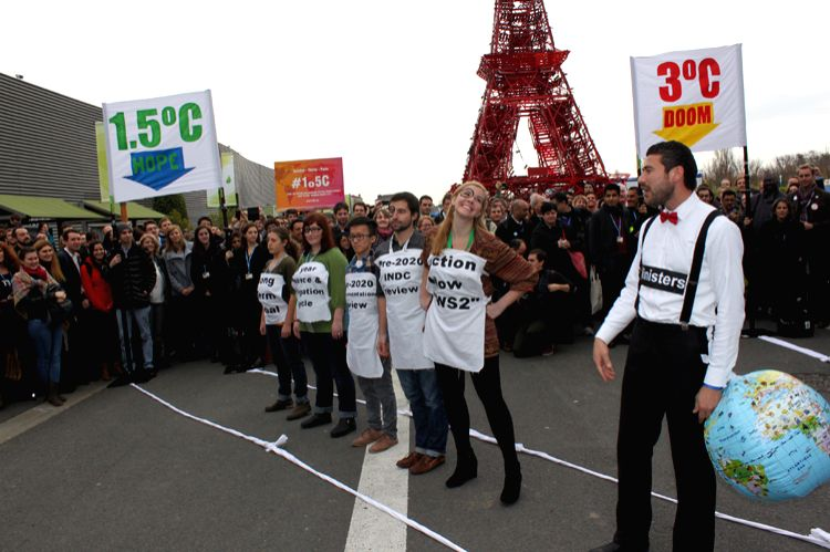 NGOs enacting CoP21 negotiations: In front of a mock Eiffel Tower at CoP21, NGOs say the ministers have to be brought in line on negotiations