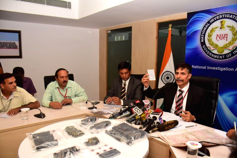 NIA IG Sanjeev Kumar displays the recovered items from the arrested Lashkar-e-Toiba (LeT) terrorist Bahadur Ali during a press conference in New Delhi on Aug 10, 2016. - Sanjeev Kumar