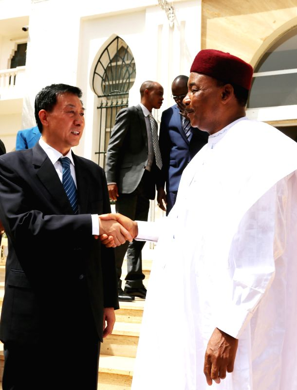 NIAMEY, June 3, 2017 - Nigerien President Mahamadou Issoufou (R) shakes hands with visiting Chinese State Councilor Wang Yong in Niamey, Niger, June 2, 2017.