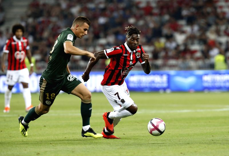 NICE, Aug. 12, 2018 - Allan Saint-Maximin (R) of Nice vies with Remi Oudin of Reims during the French Ligue 1 football match 2018-19 season 1st round in Nice, France on Aug. 11, 2018. Reims won 1-0.