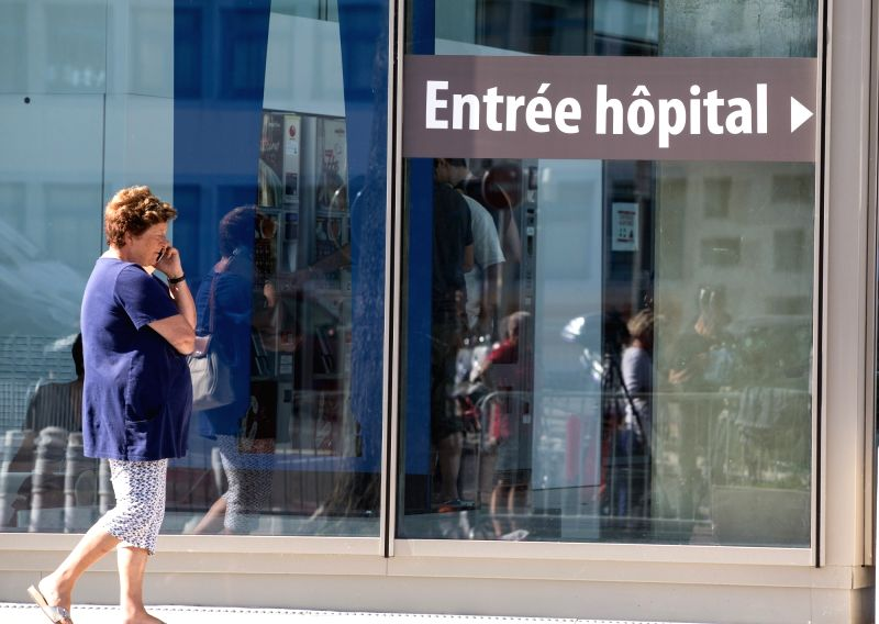 NICE, July 15, 2016 - A woman walks past the entrance of Pasteur Hospital in Nice, France on July 15, 2016. French Prosecutor of the Republic Francois Molins announced Friday in a press conference ...
