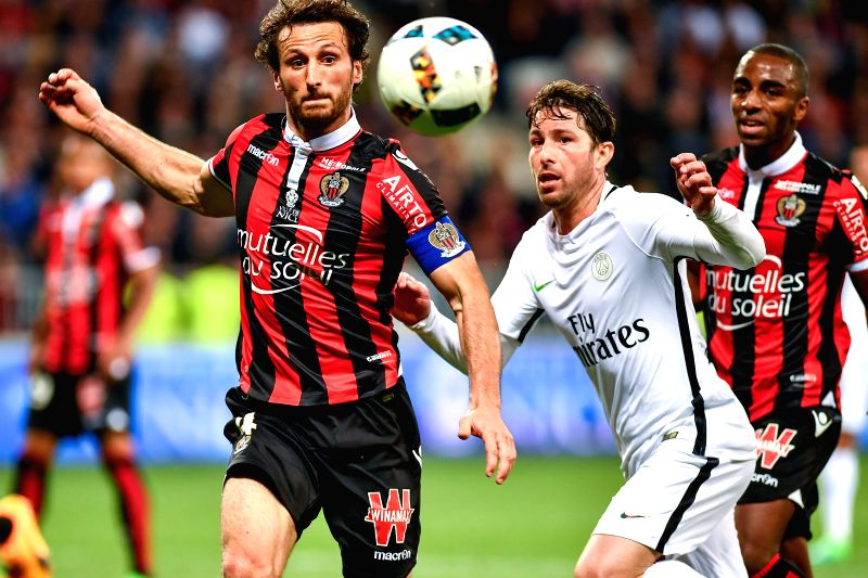 NICE, May 1, 2017 - Maxwell (R2) from Paris St Germain vies with Paul Baysse (L) from OGC Nice during the French Ligue 1 soccer match in Nice, France on April 30, 2017. OGC Nice won 3-1.