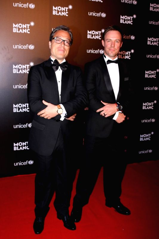 Nicolas Baretzki, CEO of Montblanc and South African cricket player AB de Villiers during the Montblanc UNICEF event in Mumbai on May 2, 2017.