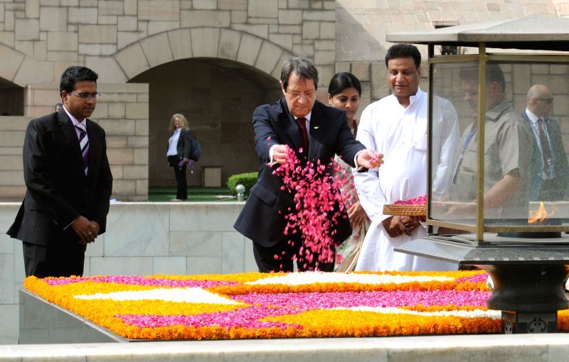 Nicos Anastasiades, President of the Republic of Cyprus paying floral tributes at the Samadhi of Mahatma Gandhi, at Rajghat, in Delhi on April 28, 2017. The Minister of State for Health ... - Anupriya Patel