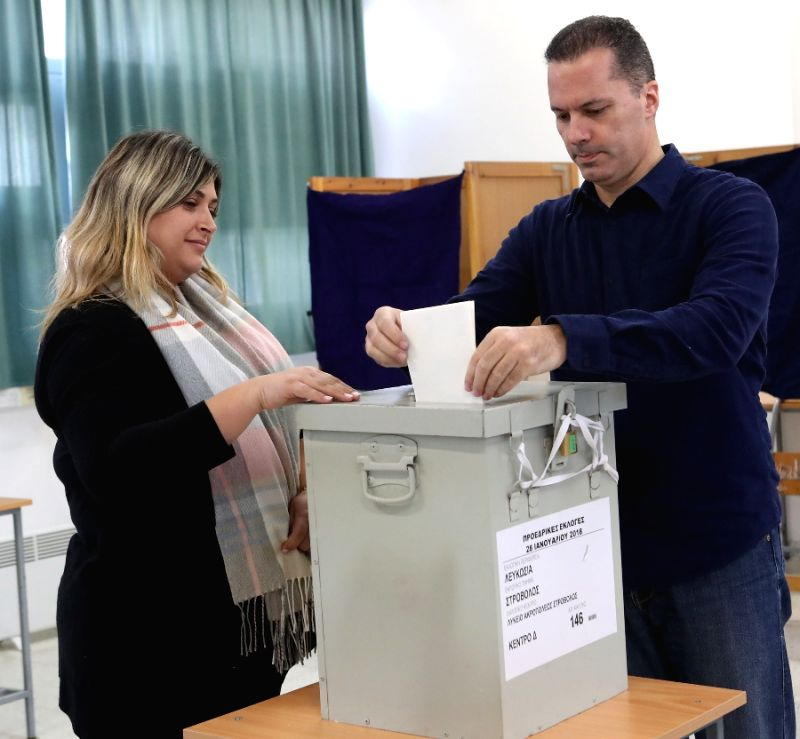 NICOSIA, Jan. 28, 2018 - A Cypriot (R) votes at a polling station in Nicosia, Cyprus, Jan. 28, 2018. Cypriots voted on Sunday in a presidential election which is said to be critical for the ...