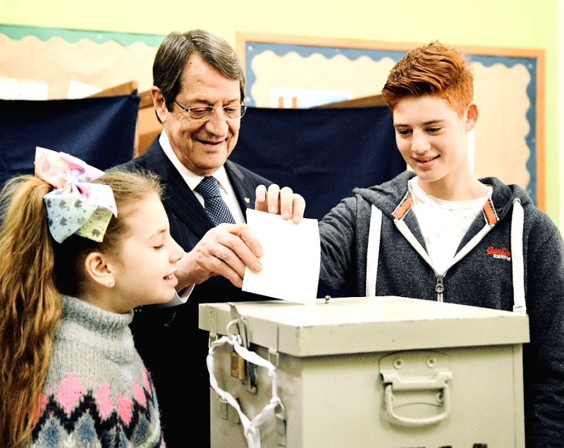 NICOSIA, Jan. 28, 2018 - Cypriot outgoing president Nicos Anastasiades votes at a polling station in his hometown city Limassol, Cyprus, Jan. 28, 2018. Cypriots voted on Sunday in a presidential ...
