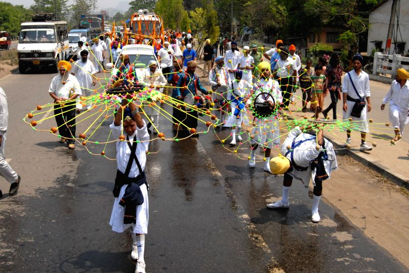 Nihang Sikh warriors demonstrate their 'gatka' skills during a procession organised on the eve of Baisakhi in Guwahati on April 13, 2014.