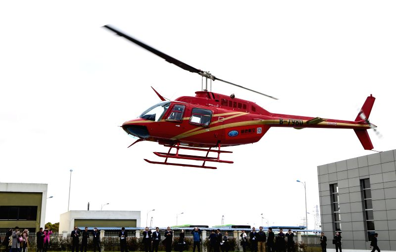 A helicopter flies in a demonstration flight at a helicopter store in Ningbo, east China's Zhejiang Province, April 8, 2015. The helicopter store was open on ...