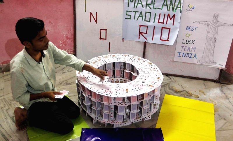 Nishant Kumar Jha, a resident of Allahabad makes a replica of Rio Olympic stadium with playing cards on Aug 4, 2016. - Nishant Kumar Jha