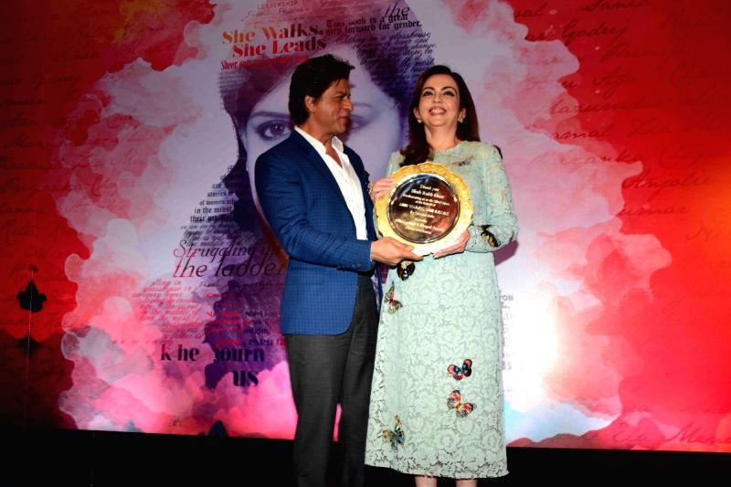 Nita Ambani and actor Shahrukh Khan during the launch of author Gunjan Jain book She Walks She Leads, in Mumbai, on July 21, 2016. The Book features Priyanka Chopra and Kareena Kapoor Khan. - Shahrukh Khan, Nita Ambani, Gunjan Jain, Priyanka Chopra and Kareena Kapoor Khan