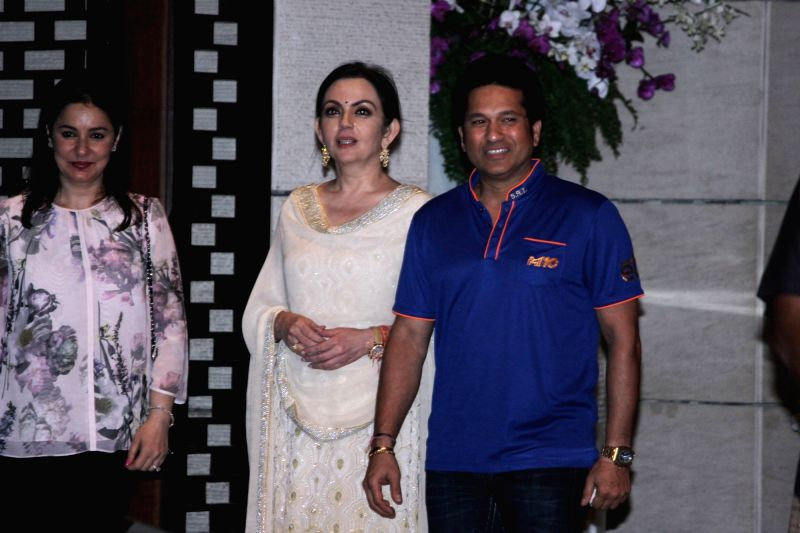 Nita Ambani owner of Mumbai Indians along with former Indian cricket player and Mumbai Indians icon player Sachin Tendulkar with his wife Anjali Tendulkar during the party organised to ... - Sachin Tendulkar and Nita Ambani