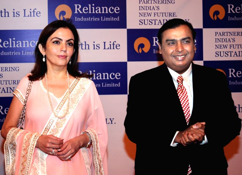 Nita & Mukesh Ambani (Chairman & Managing Director, Reliance Industries Ltd.) at RIL`s 38th Annual General Meeting held on 7th June 2012 at Birla Matushri Sabhagar in Mumbai. - Mukesh Ambani