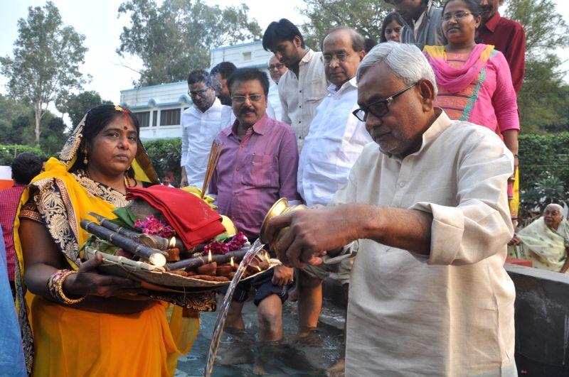 Nitish Kumar celebrates Chhath Puja in Patna on Nov 17, 2015.