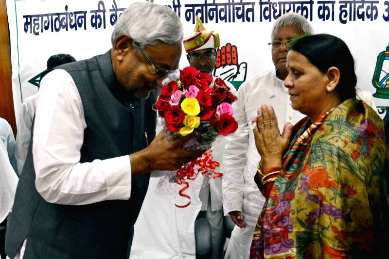 Nitish Kumar with RJD leader Rabri Devi after being elected the leader of JD(U) legislative party in Patna, on Nov 14, 2015. - Nitish Kumar