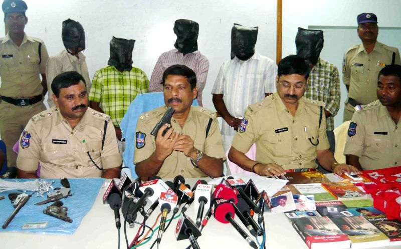 Nizamabad Superintendent of Police S. Chandrasekhar Reddy displays arms recovered from maoists in Nizamabad, Telangana on March 27, 2015. - S. Chandrasekhar Reddy