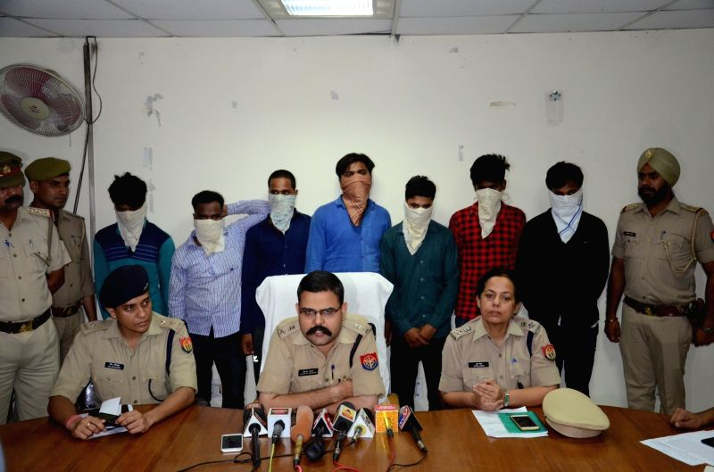 Noida: Police present before press seven persons arrested in connection with a gangrape case in Noida on June 19, 2019.