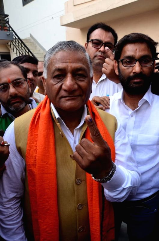 Noida: Union MoS External Affairs General V.K. Singh shows his inked finger after casting vote for Lok Sabha election, in Noida, on April 11, 2019. (Photo: IANS)