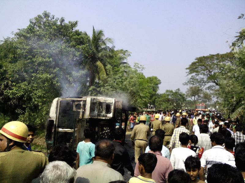 North 24 Pargana: Mob set a bus on fire as a motorcyclist was killed in a road accident involving two buses in Aamdanga of West Bengal's North 24 Parganas district on Feb 12, 2015.