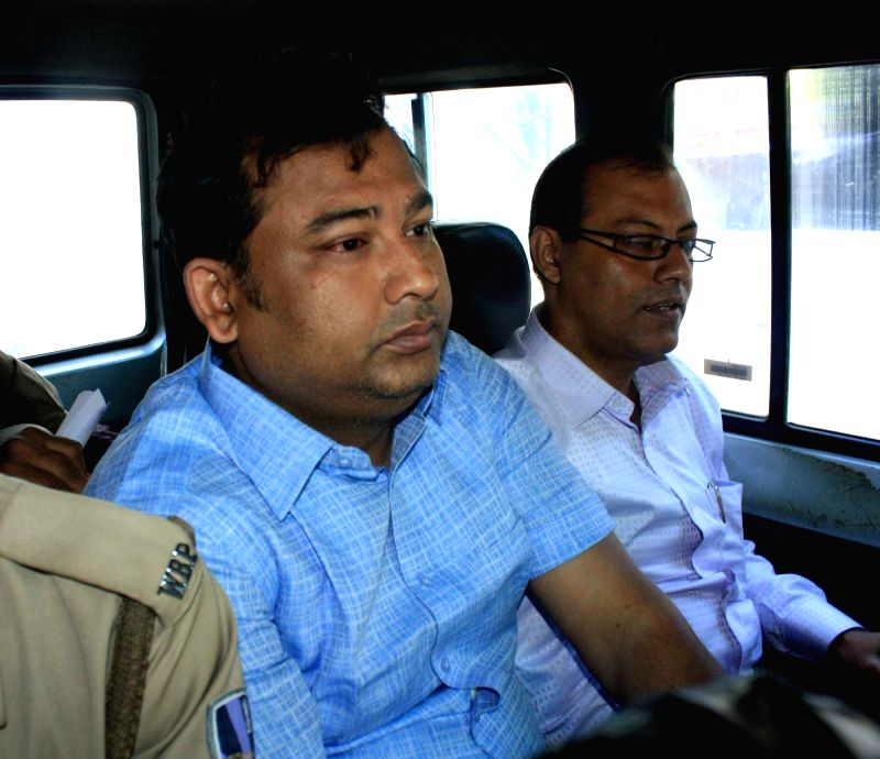North 24 Parganas: Industrialist Shibaji Panja being taken to be produced in a Barrackpore court in West Bengal's North 24 Parganas on Feb 22, 2015.