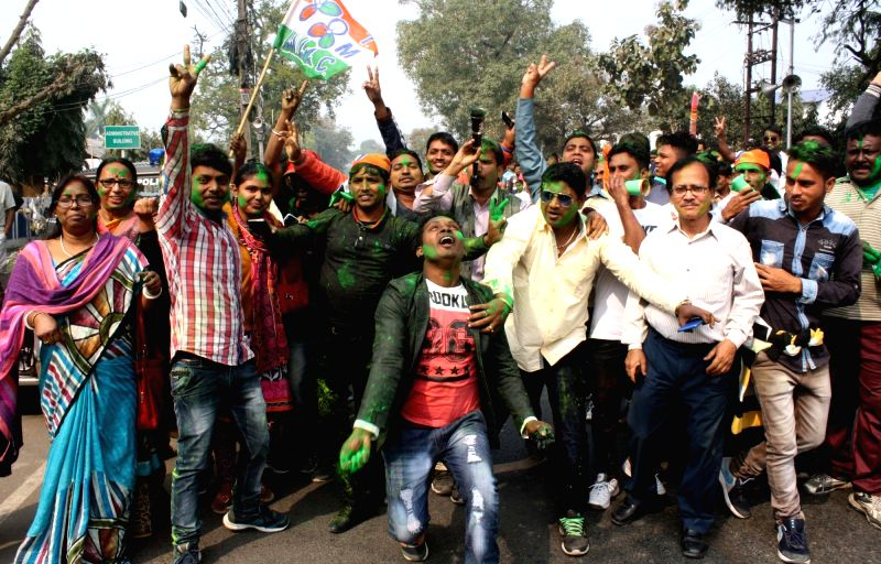 North 24 Parganas: TMC workers celebrate after the party won Noapara by-polls; in North 24 Parganas on Feb 1, 2018.