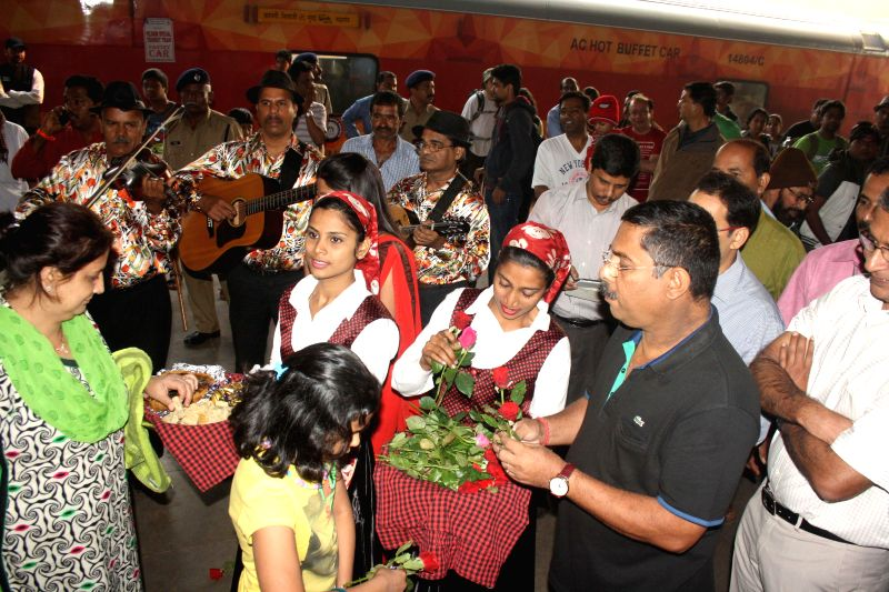 North Goa: Goa Tourism Minister Dilip Parulekar welcomes tourists at Thivim Railway Station after the first holiday special train arrived in Goa on Dec 30, 2014.