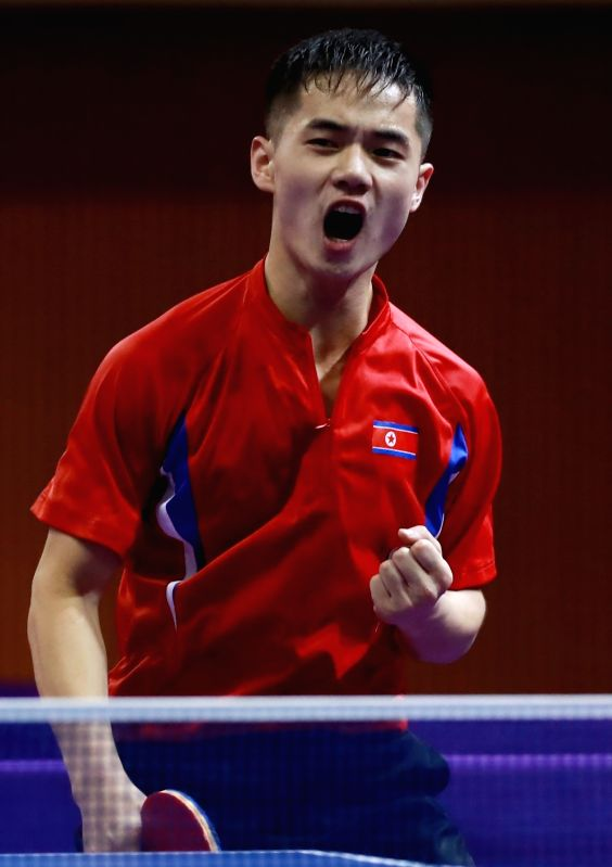 North Korea's Ham Yu-song reacts after scoring a point during the under-21 singles final of the International Table Tennis Federation (ITTF) World Tour Platinum Korea Open in Daejeon, 160 ...