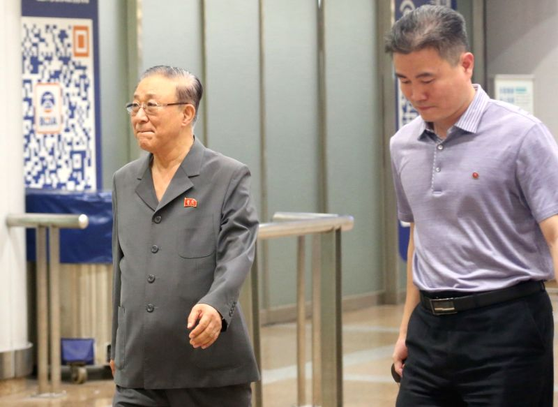 North Korean Ambassador to China Ji Jae-ryong (L) arrives at an airport in Beijing on July 24, 2018, 12 days after he returned to Pyongyang when North Korean leader Kim Jong-un summoned ...