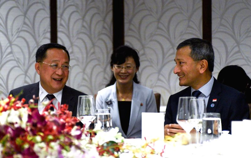 North Korean Foreign Minister Ri Yong-ho (L) attends a meeting with Singapore's Foreign Minister Vivian Balakrishnan in Singapore on Aug. 6, 2018, in this photo captured from the Facebook ... - R