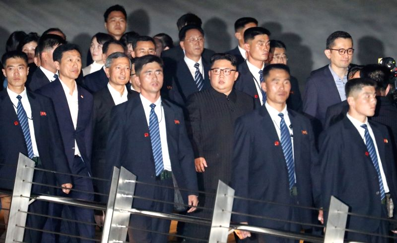 North Korean leader Kim Jong-un is surrounded by bodyguards during a tour of the Esplanade in Singapore on June 11, 2018, the eve of a historic summit with U.S. President Donald Trump.