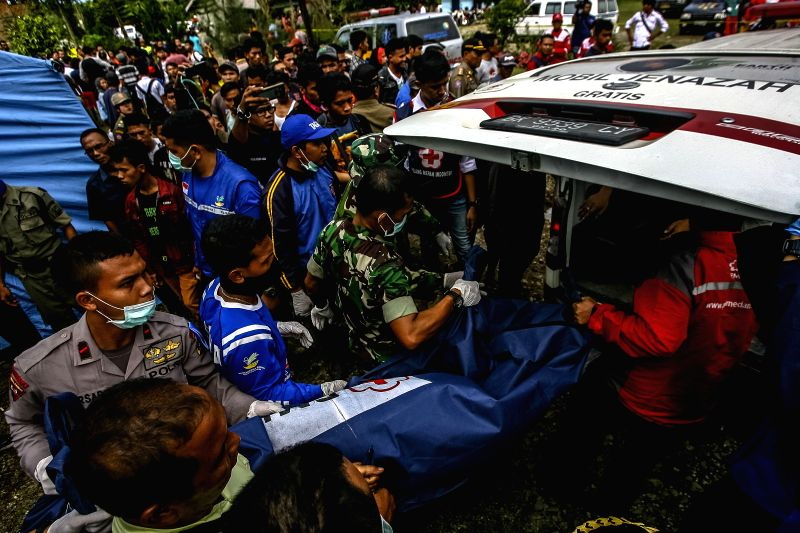 NORTH SUMATRA, May 16, 2016 - Members of search and rescue teams transfer the body of a victim in flash floods to an ambulance at Deli Serdang in North Sumatra, Indonesia, May 16, 2016. Flash floods ...