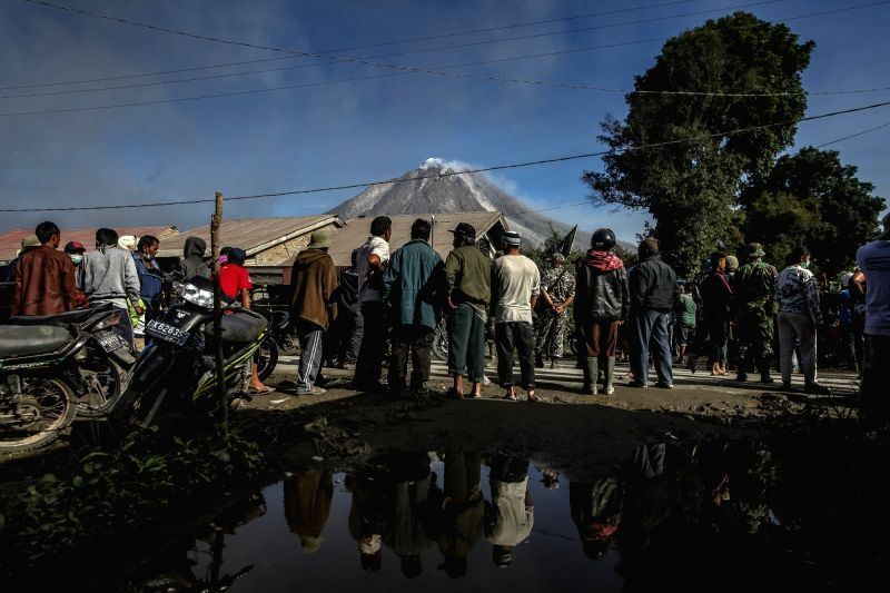 NORTH SUMATRA, May 22, 2016 - People wait for evacuation process after the eruption of Mount Sinabung in Gamber village, North Sumatra, Indonesia, on May 22, 2016. The death toll from the volcano ...