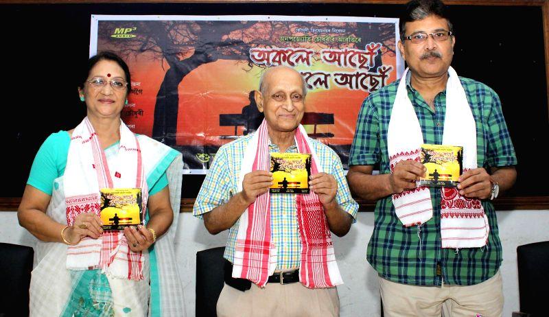 Noted Assamese film actress Madhurima Kakoti , Noted dramatist Kuloda Kumar Bhattacharya along with other dignitaries releasing an Audio CD  titled ``Okole Aasu Kukhole Aasu`` at Guwahati Press Club . - Madhurima Kakoti and Kuloda Kumar Bhattacharya