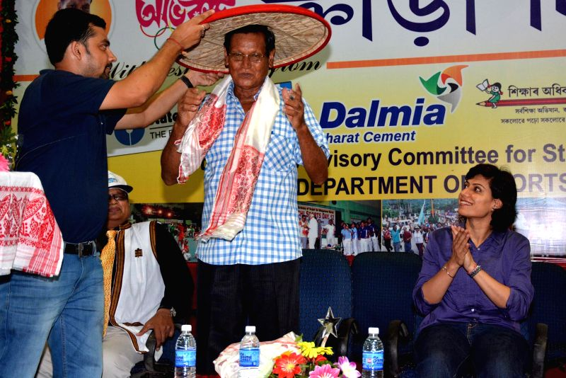Noted athlete Bhogeswar Baruah being felicitated on his birthday which is being celebrated as 31st Abhiruchi Sports Day celebrations in Guwahati on Sept 3, 2014.