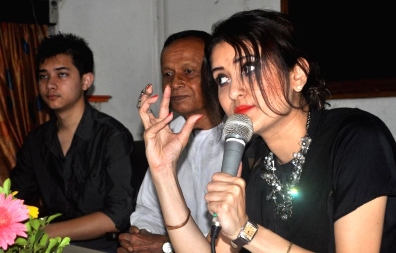 Noted dancer and choreographer Dr. Menaka P. P. Bora addresses a press conference at a Press Club regarding 'Confluence' in Guwahati on April 28, 2014.