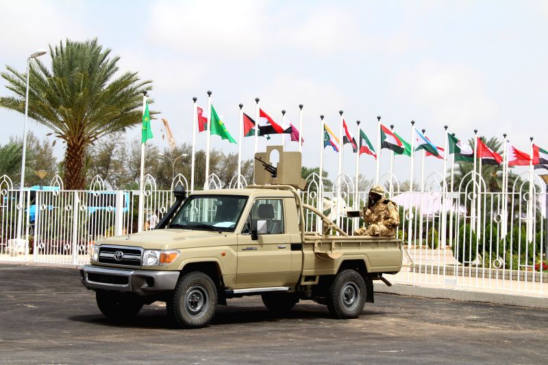 NOUAKCHOTT, July 24, 2016 - A security member is seen on a military vehicle in front of Nouakchott Convention Center in Nouakchott, capital of Mauritania, on July 23, 2016. The 27th Arab League ...