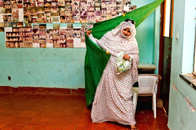 A woman casts her ballot at a polling station in Olympic Stadium in Nouakchott, capital of Mauritania, June 21, 2014. More than 1.3 million voters are expected ..