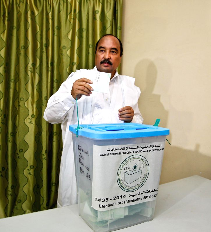 Incumbent Mauritanian President and presidential election candidate Mohamed Ould Abdel Aziz casts his ballot at a polling station in Nouakchott, capital of ...
