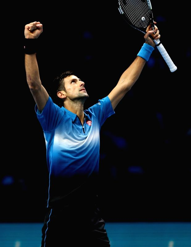 Novak Djokovic of Serbia celebrates victory after the semifinal against Rafael Nadal of Spain at the ATP World Tour Finals in London, Britain, Nov. 21, 2015. ...