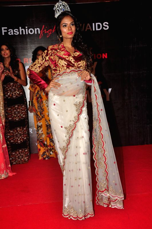 Noyonita Lodh, Miss Diva Universe 2014 walks the ramp for AIDS awareness on World Aids Day to make India AIDs stigma free in Mumbai on Dec 1, 2014.