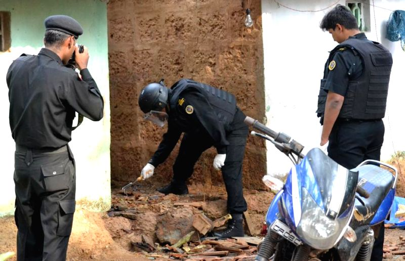 NSG commandos collect evidence from the house where a crude bomb exploded on 8th May, 2014 at Nessai near Margao in south Goa; on May 9, 2014.