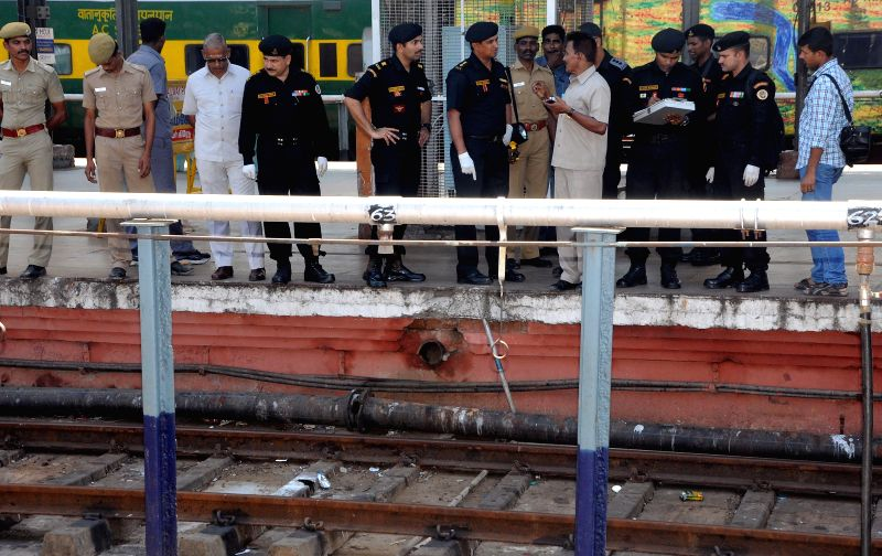 NSG commandos inspect the spot at Chennai Railway station where two bomb blasts took place in two different coaches of Guwahati-Bangalore train as it chugged into the station on 1st May, in Chennai ..