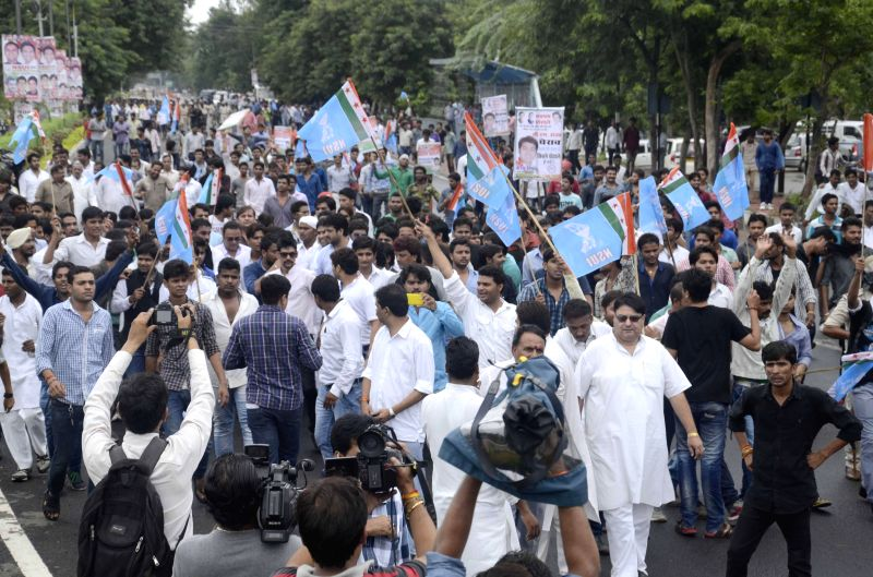 NSUI activists demonstrate against MPPEB scam in Bhopal on July 18, 2014.