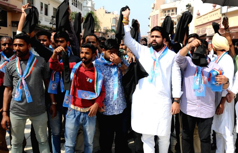 NSUI activists show black flag to Union Home Minister Rajnath Singh in Amritsar on March 13, 2018. - Rajnath Singh