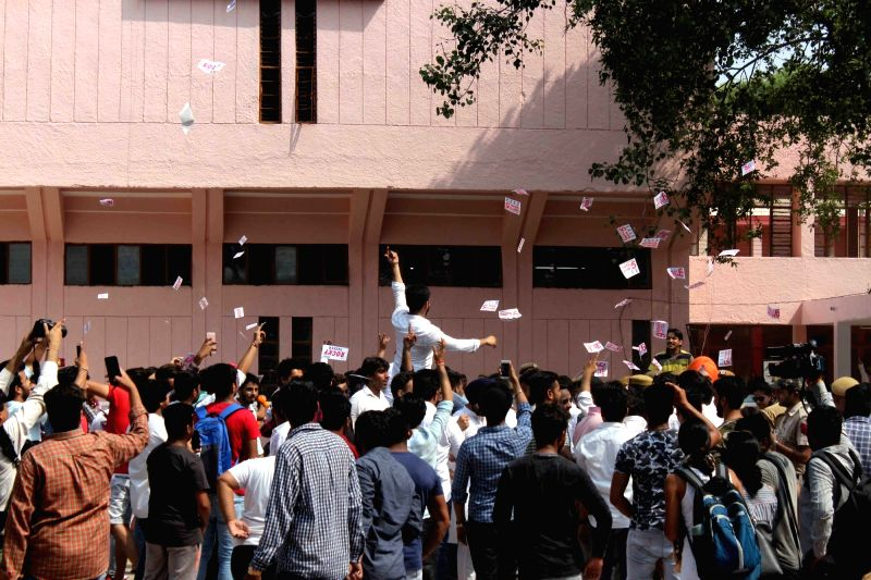 NSUI members celebrate after it bagged the posts of President and Vice President in the Delhi University Students Union (DUSU) elections in New Delhi on Sept 13, 2017.