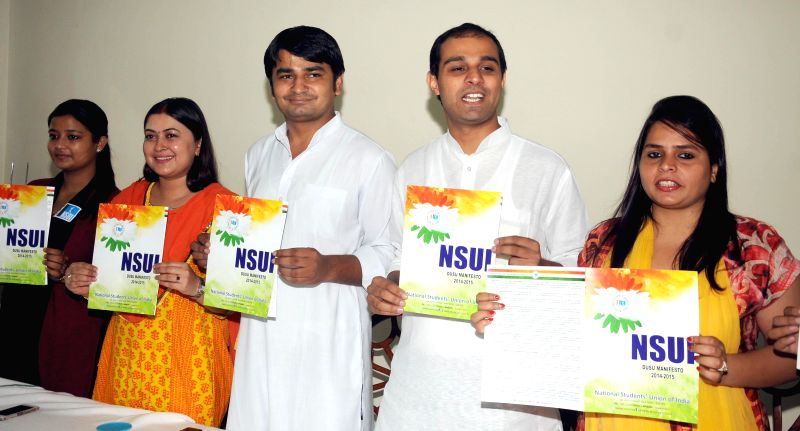 NSUI president Roji John and vice president Amrita Dhawan release manifesto for DUSU 2014-2015 during a press conference in New Delhi on Sept 4, 2014.
