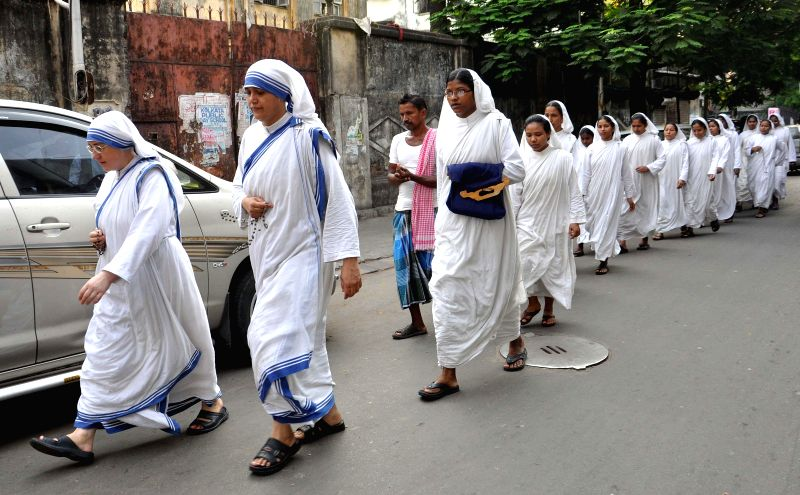 Nuns proceed towards the church to offer prayers on Good Friday in Kolkata on April 18, 2014.
