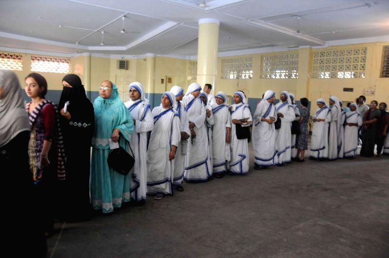 Nuns queue-up to cast their votes at a polling booth during the ninth phase of 2014 Lok Sabha Polls in Kolkata on May 12, 2014.