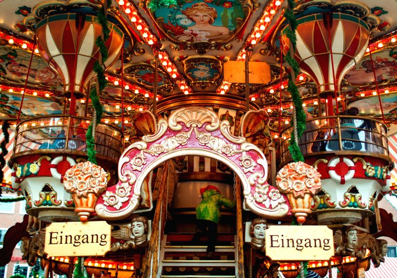 Nuremberg (Germany): A child climbs on a merry-go-round at the Children's Christmas Market, in Nuremberg, Germany, on Nov. 29, 2014. Found in 1999, the annual Children's Christmas Market in Nuremberg