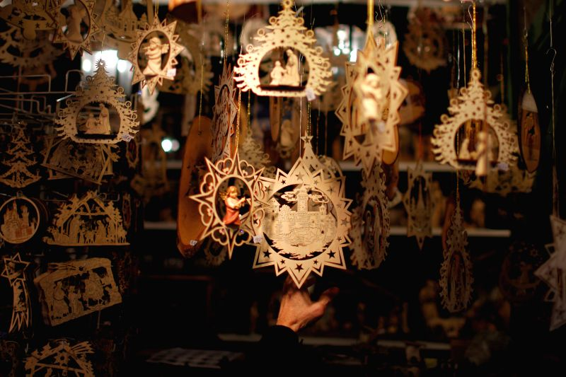 A visitor views Christmas decorations at the Nuremberg Christmas Market in Nuremberg, Germany.
