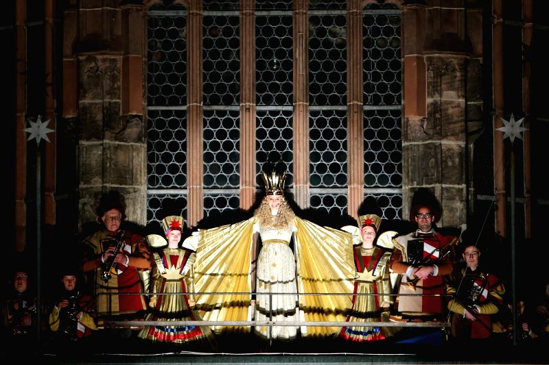 """Nuremberg (Germany): The """"Christkind"""" (C) gives a ceremonial prologue at the Nuremberg Christmas Market in Nuremberg, Germany, Nov. 28, 2014. The Nuremberg Christmas Market, one of the ..."""